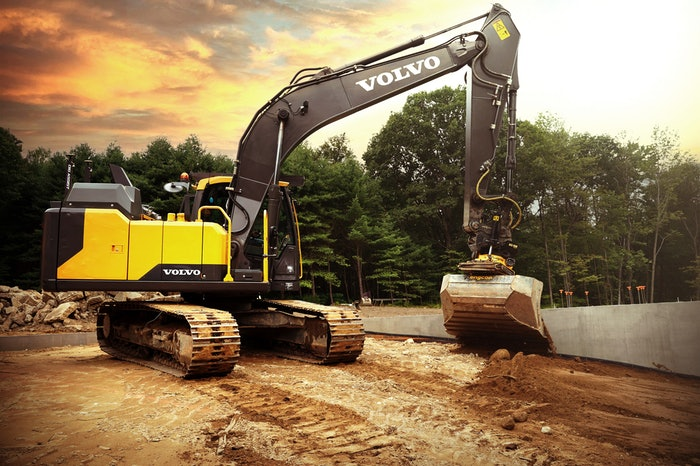 Volvo machine digging in dirt