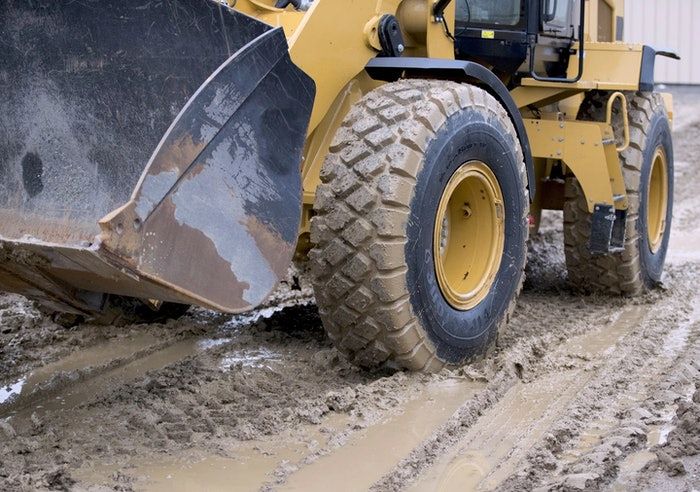 heavy duty machinery tracking through the mud