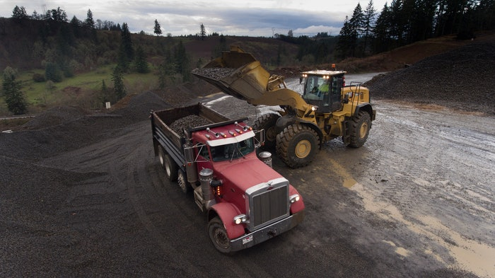 Caterpillar 980XE wheel loader loading truck