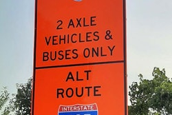 Orange sign with I-95 2 Axle vehicles & buses only on top and alt route I-495 on bottom