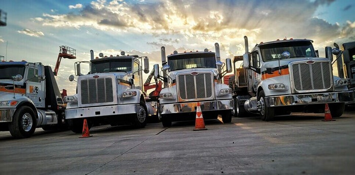 H&E Equipment Services trucks parked in a row